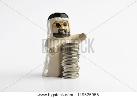 A figure of an Emirati man with UAE dirham coins. Isolated image.