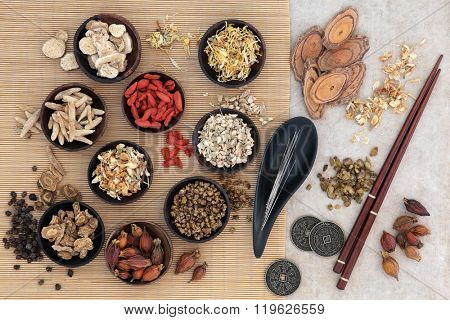 Acupuncture needles, traditional chinese herbs for herbal medicine, i ching coins and chopsticks.