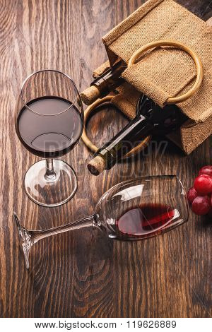 Glasses With Wine, Bottles And Bunch Of Grapes, Wooden Background