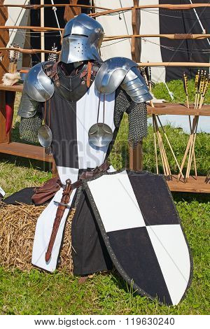 Knight armor on display during tournament reconstruction poster