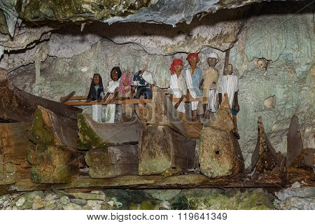Tana Toraja, Indonesia - Dec 08, 2015: Wooden statues of Tau Tau and coffins in Tampang Allo burial cave of the royal family. Tana Toraja. South Sulawesi. Indonesia