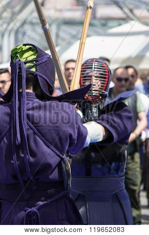 Two Kendo Fighters Competition With Bamboo Sword And Traditional Clothes