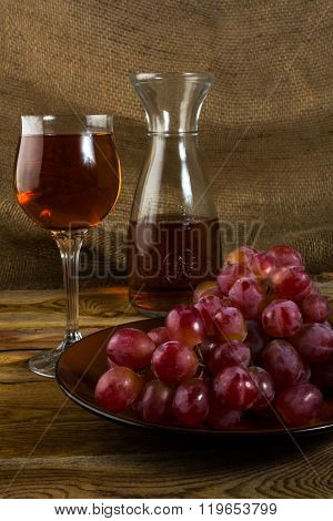 Red Grapes On Dark Wooden Background