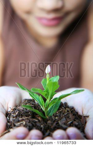 Girl holding a new flower