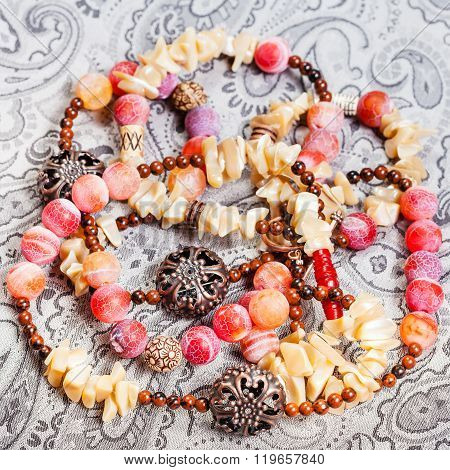Above View Of Tangled Pink And Yellow Necklace