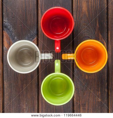 Four Color Tea Cups Arranged In A Cross