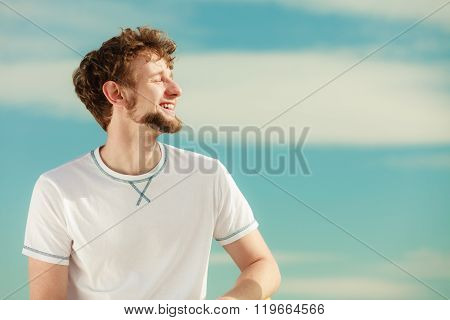 Man With Closed Eyes Relaxing Breathing Fresh Air.