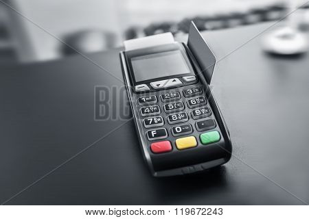 Bank terminal and payment card.