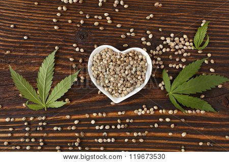 Hemp Seeds On Wooden Background.