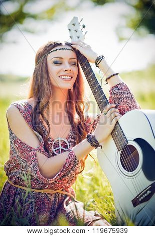 Portrait Of Beautiful Smiling Hippie Woman With Guitar. Outdoor Shot