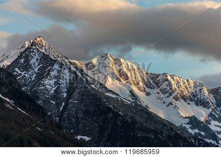 Snowy Mountains In Evening Light