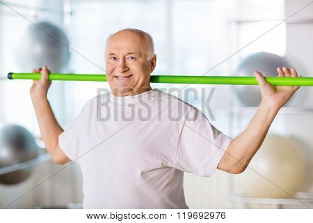 Senior man holding sport stick