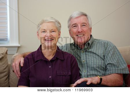 Senior Couple Sitting Together In Their Home