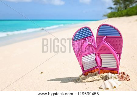 Pinks Flip-flops On A Sunny Sandy Beach..tropical Beach Vacation And Travel Concept.