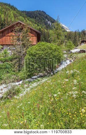 Alpine Hut And Mountain Stream