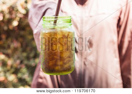 Woman Hand Holding Iced Soda In Green Glass