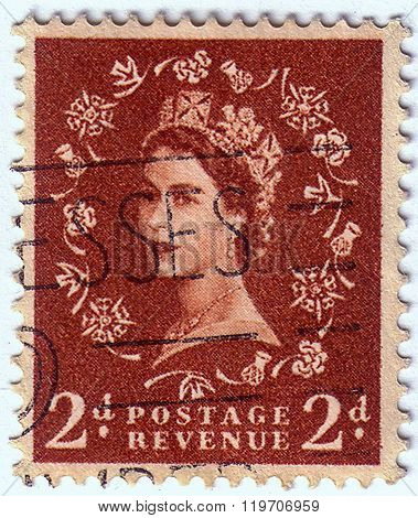 United Kingdom - Circa 1952 To 1965: An English Two Pence Brown Used Postage Stamp Showing Portrait