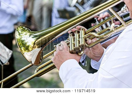 Military Musician Blowing His Gold Trombone