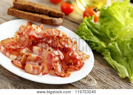 Crispy Strips Of Bacon On A Grey Wooden Background