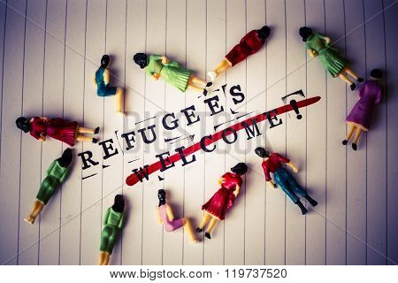 Refugees Welcome Strikethrough Text On Paper