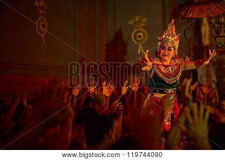 UBUD, INDONESIA - FEB 27, 2016: Unidentified dancers performing traditional balinese Kecak Fire Dance. Was originally a trance ritual, depicts a battle from the Ramayana, dance was developed in 1930s.