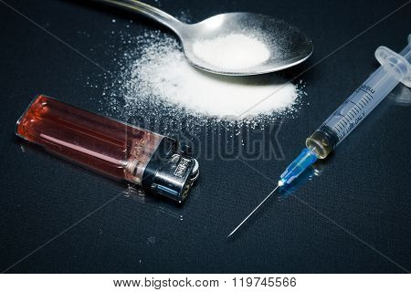 syringe , heroin, cocaine, spoon