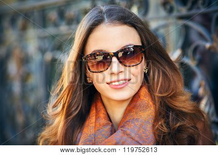 Outdoor Portrait Of Beautiful Redhead Young Woman In Sunglasses