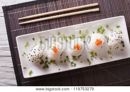 Onigiri Rice Balls Close-up On A Plate. Horizontal  Top View