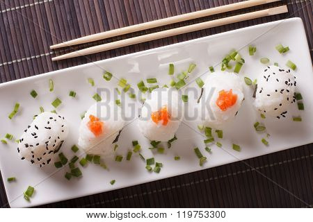 Japanese Onigiri With Salmon And Sesame Close-up. Horizontal Top View