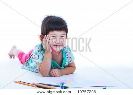 Child Lie On The Floor Drawing On Paper And Smiling. On White