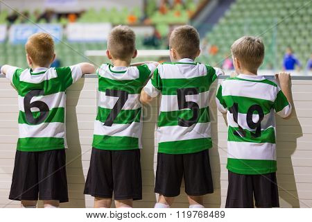 Football Soccer Match For Children. Kids Waiting And Watching Soccer Game. Sports Youth Teams Compet