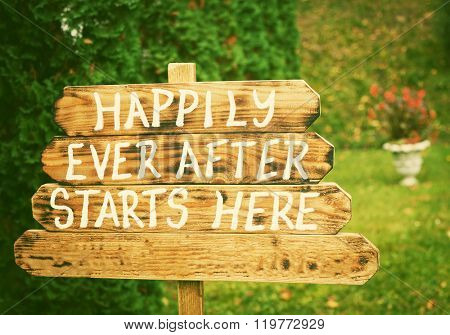 Happily ever after sign on wooden board - wedding venue or honeymoon sign. Vintage photo