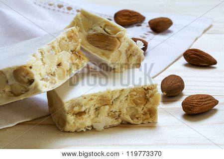 Italian Festive Torrone Or White Nougat With Almonds, Close Up