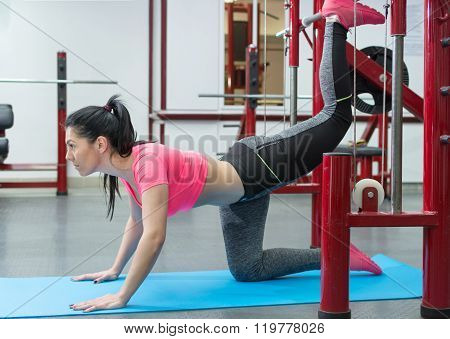 Girl girl doing gluteus exercises