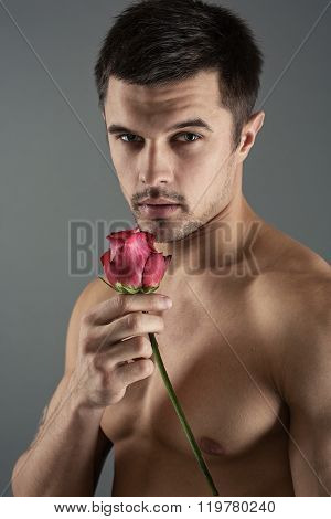 Portrait Of A Handsome Man With A Rose
