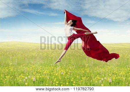 Female Model With Fabric Jumps At Field