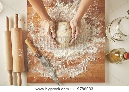 Woman Hands Hold Prepared Dough Top View