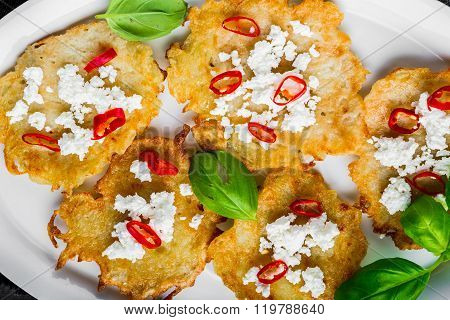 Potato Pancakes With Goat's Curd, Chili Peppers And Basil