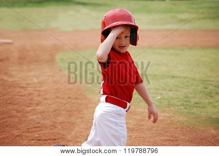 Little league baseball player during game.