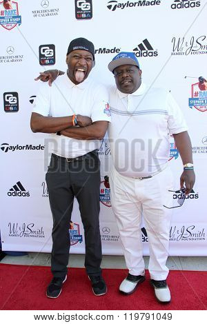 Ricky Smith and Cedric the Entertainer arrives at the inaugural Stephen Bishop celebrity golf invitational benefiting R.A.K.E. on Feb. 15, 2016 at Calabasas Country Club in Calabasas, CA.