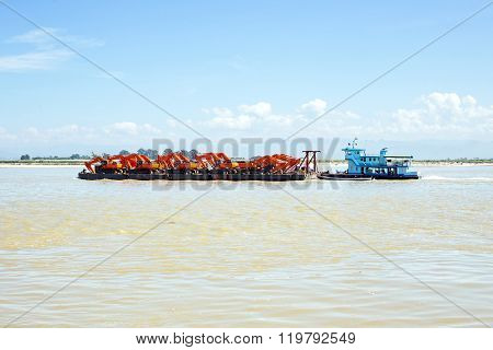 Pusher with cranes on the Ayarwaddi river in Myanmar