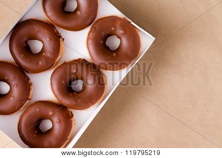 Top Down View Of Chocolate And Cream Donuts In Box