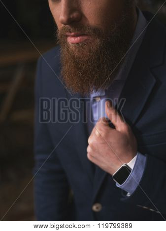 Successful young bearded businessman in a suit