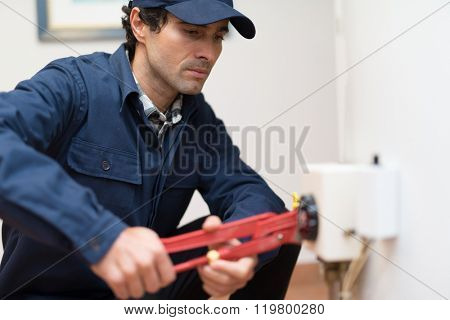 Plumber fixing an hot-water heater