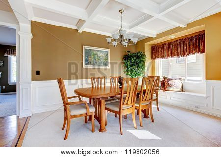 Simple Dinning Room With Carpet And Beige Walls.