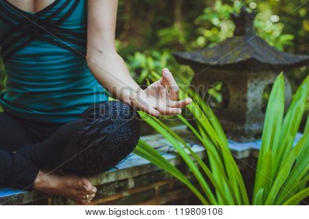 A Young Woman Doing Meditation Outdoors In Tranquil Environment