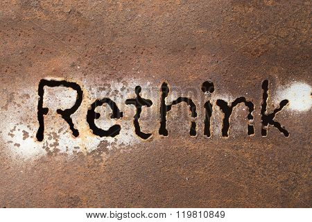 Rethink Word On Rusty Steel Sheet