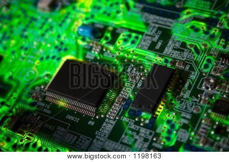 green electronic board with chips illuminated from bottom poster