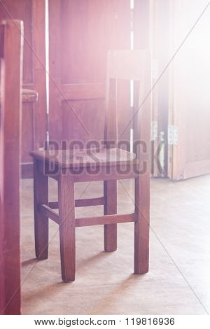 Old Style Wooden Chair In Coffee Shop With Vintage Filter