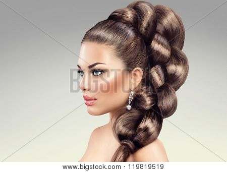Hair Braid. Beautiful Woman with Healthy Long Hair. Hairdressing. Plait Hairstyle. Beauty fashion girl with perfect make up posing over gray background, Healthy skin and long shiny hair poster